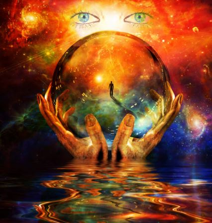 Mystical image - two hand holding a crystal ball emerging from water. Background there is a beautiful pair of blue eyes.